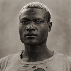 Tribal Man in Transition, Kenya, 1985. Portrait by Dana Gluckstein